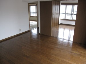 with polished hardwood floor and new wallpaper